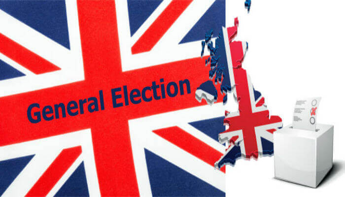 uk general elections sign on a british flag
