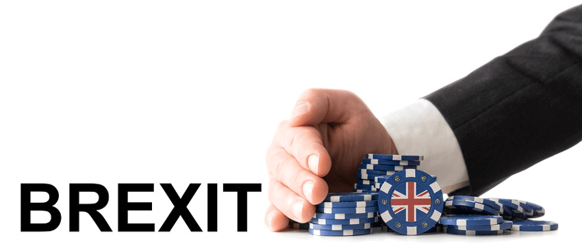 brexit man taking casino chips with uk flag