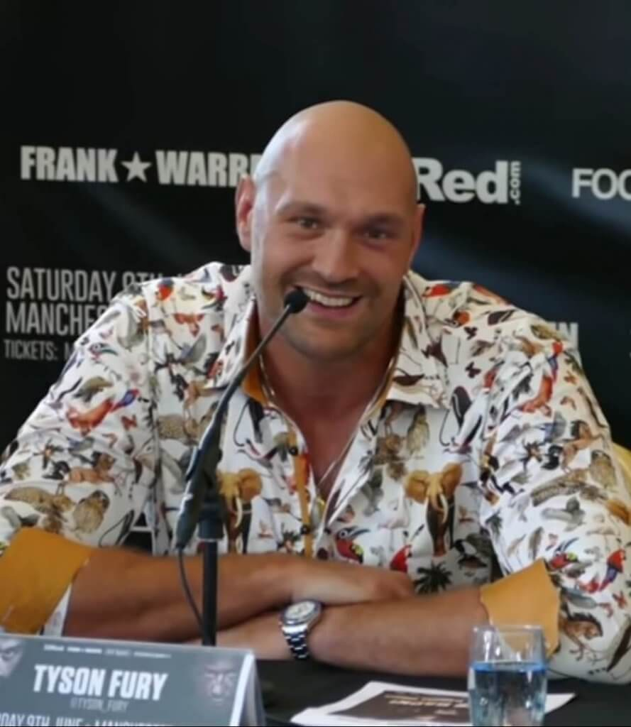 tyson fury speaking at a conference