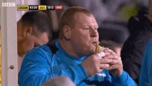 Wayne Shaw eating a pie